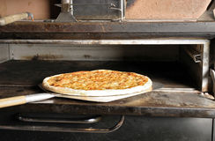 Cheese Pizza from the Oven. Cheese Pizza being pulled from the oven Stock Images