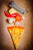 Cheese pizza slice. With food ingredients on a wooden background Stock Images