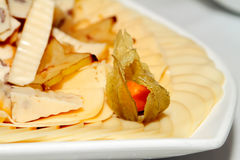 Cheese plate. With physalis on the table Stock Images