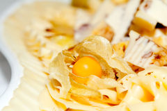 Cheese plate. With physalis on the table Royalty Free Stock Photography
