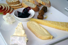Cheese Plate. Australian cheeses on a plate with fruit and crackers Royalty Free Stock Images
