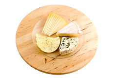 Cheese plate. A plate with four types of cheese on wooden tablet isolated on white background Royalty Free Stock Photo