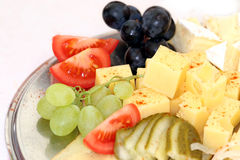 Cheese plate. Plate with cheese and fruit Stock Photo