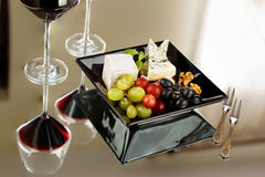 Cheese plate. Along some wine, grapes and nuts stock images