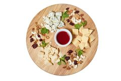 Cheese plate antipasti snack with mixed Italian cheese, cashew, fresh mint leaves stock image