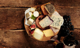 Cheese plate with assorted cheese Royalty Free Stock Images