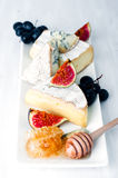 Cheese plate Assortment of various types   and honey Royalty Free Stock Image