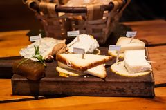 Cheese plate of Asturian cheese: Cabrales, Afuega'l Pitu, Vidiago, Queso de Oveja sheep milk cheese and Ahumados smoked cheese royalty free stock photos