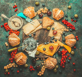 Cheese plate with berries ,honey dip and buns on dark rustic background Stock Images