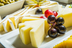 Cheese plate with berris. Royalty Free Stock Photography