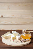Cheese plate with Brie, Camembert, Roquefort Royalty Free Stock Photography