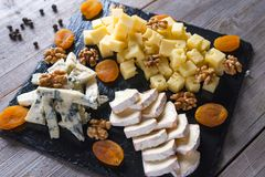 Cheese plate. On wooden background stock photos