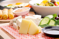 Cheese plate, cheese rolls and lentil salad /Mediterranean cuisine Stock Images