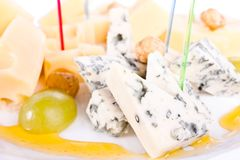 Cheese. A plate of cheeses. Plate with three kinds of cheese on skewers. And grapes Stock Photography