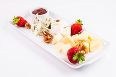Cheese plate with cheeses Dorblu, Brie, Camembert and Roquefort Stock Photo