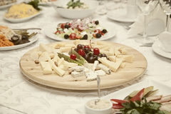 Cheese plate on the festive table Stock Image