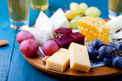 Cheese plate with fresh grape, honey, nuts,plum jelly, marmalade Stock Photo