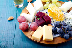 Cheese plate with fresh grape, honey, nuts,plum jelly, marmalade Stock Photos