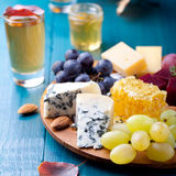 Cheese plate with fresh grape, honey, nuts,plum jelly, marmalade Stock Photography