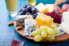 Cheese plate with fresh grape, honey, nuts,plum jelly, marmalade Royalty Free Stock Images
