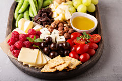 Cheese plate with fresh vegetables and fruits Royalty Free Stock Photography