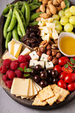 Cheese plate with fresh vegetables and fruits Stock Photos