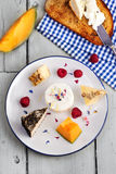 Cheese plate with fruits Royalty Free Stock Images