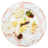 Cheese plate with fruits and nuts Stock Photo