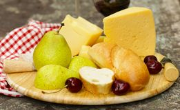 Cheese plate with fruits and wine Royalty Free Stock Image
