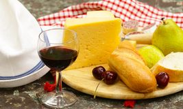 Cheese plate with fruits and wine Stock Photography