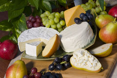 Cheese plate with grape and pear. Various cheese plate with fruits Royalty Free Stock Photos
