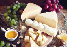 Cheese plate with grape Royalty Free Stock Photography