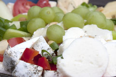 Cheese plate and grapes. Dietary lunch Stock Photos