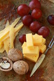 Cheese plate with grapes Stock Images