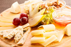 Cheese plate with grapes Royalty Free Stock Images