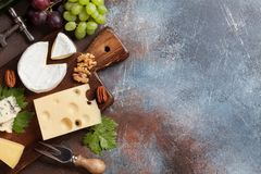 Cheese plate. With grapes and nuts. Wine snaks. Top view with space for your text stock photos