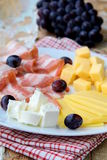 Cheese plate with grapes  and smoked bacon Royalty Free Stock Images