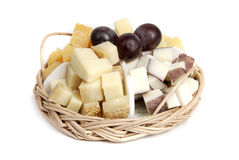 Cheese plate with grapes Stock Photos