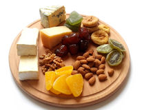 Cheese plate. healthy food. Blue cheese. Hard cheese. fruit and nuts Royalty Free Stock Images