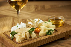 Cheese plate with honey and wine Royalty Free Stock Image
