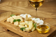 Cheese plate with honey and wine Stock Photo