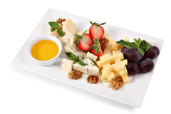 Cheese plate, isolated on white background Stock Photos