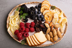 Cheese plate with nuts and berries Stock Image