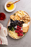 Cheese plate with nuts and berries Royalty Free Stock Photography