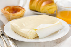 Cheese on plate with pastel de nata Royalty Free Stock Photos