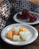 Cheese Plate with Red Seedless Grapes` Royalty Free Stock Photography