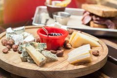 Cheese plate in restaurant Stock Images
