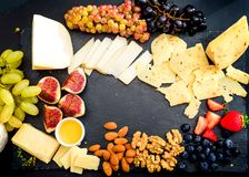 Cheese plate served with grapes, jam, figs Stock Photos