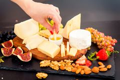 Cheese plate served with grapes, jam, figs stock photography