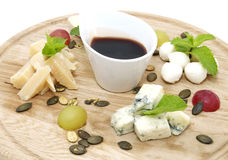 Cheese plate with several varieties of cheese Royalty Free Stock Image